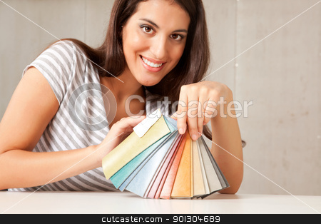 Color Swatch stock photo, A young female interior designer displaying a group of color swatches.  Sharp focus on swatches by Tyler Olson