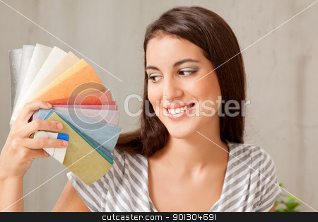 Color Swatch Pick stock photo, A young femail looking at a group of color swatches by Tyler Olson