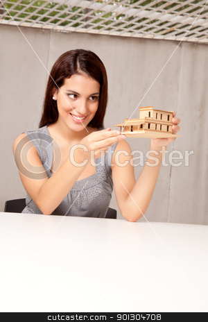 Happy Architect with Model stock photo, An architect happy with a model house design by Tyler Olson