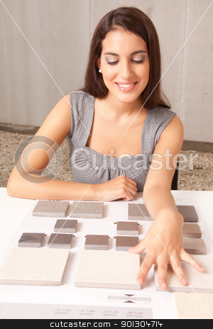 Stone Swatch Tiles stock photo, A designer looking at stone swatch tiles on table by Tyler Olson