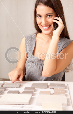 Choosing Stone tile stock photo, A designer talking on the phone choosing a stone tile by Tyler Olson