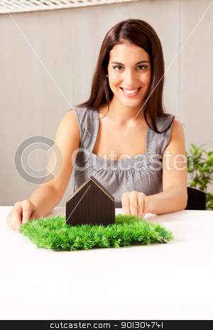 Green Living Concept stock photo, A design professional showing a green living concept - sharp focus on house by Tyler Olson