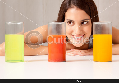 Three Science Beakers with Liquid stock photo, A woman looking at three science beakers filled with colored liquid by Tyler Olson
