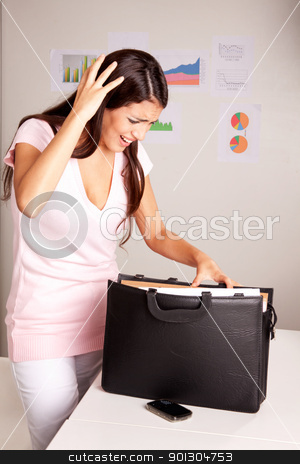 Lost Document stock photo, A stressed women who is looking for a lost document by Tyler Olson