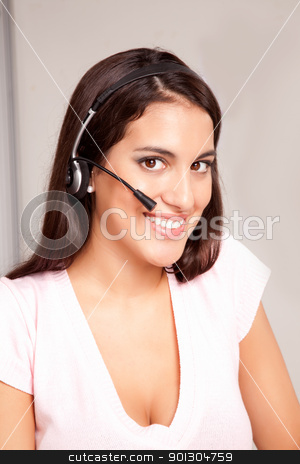 Call Center Woman stock photo, A woman at a call center smiling at the camera by Tyler Olson