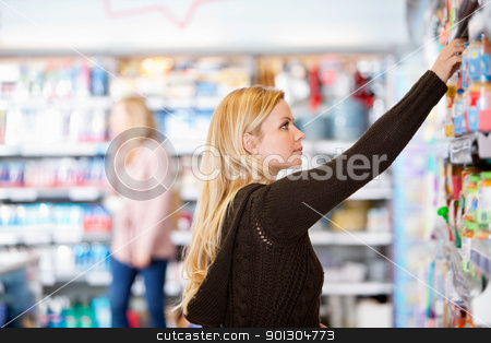 Young Woman Shopping stock photo, Young woman shopping in the supermarket by Tyler Olson