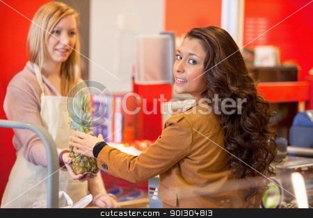 Grocery Store Woman stock photo, A woman buying fruit and vegetables in a grocery store by Tyler Olson