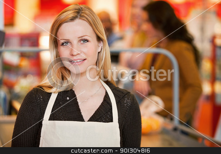 Shop Owner stock photo, Portrait of a shop owner in the cashier area of the store by Tyler Olson