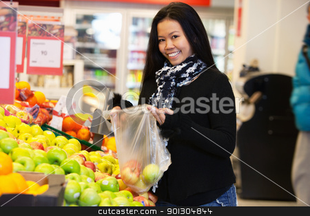 Asian Woman in Supermarket stock photo, Portrait of a happy young woman buying apple in the supermarket by Tyler Olson