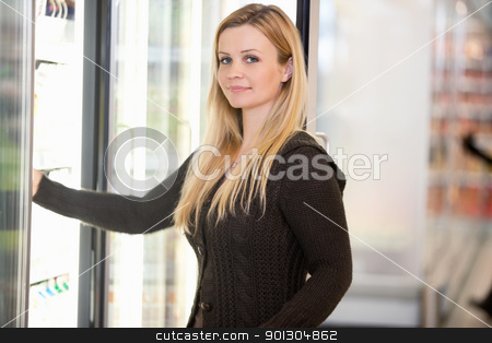 Woman Buying Cold Food stock photo, Portrait of a woman in a grocery store buying cold food by Tyler Olson