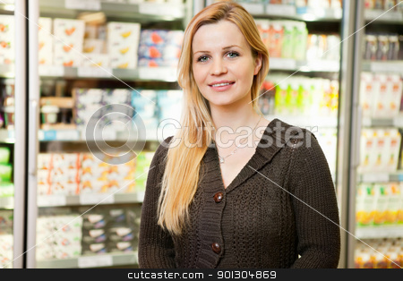Supermarket Woman Portrait stock photo, Close-up of beautiful woman smiling and looking at camera in shopping centre by Tyler Olson