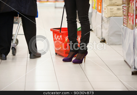 Low section of shoppers in shopping centre stock photo, Low section of shoppers in shopping centre by Tyler Olson