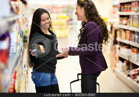 Happy Grocer Store Women stock photo, Cheerful women having conversation in shopping centre while holding product by Tyler Olson