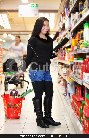 Asian Woman with Tablet Computer stock photo, Full length of a woman with shopping basket holding tablet pc in shopping store by Tyler Olson