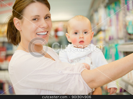 Baby and Mother in Grocery Store stock photo, A happy baby and mother in a grocery store buying groceries by Tyler Olson