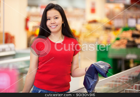 Portrait of smiling woman in store stock photo, Smiling woman holding product in shopping centre and looking at camera by Tyler Olson