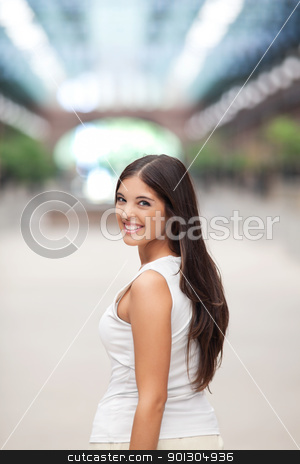 Pretty female smiling stock photo, Attractive young female smiling while looking back by Tyler Olson