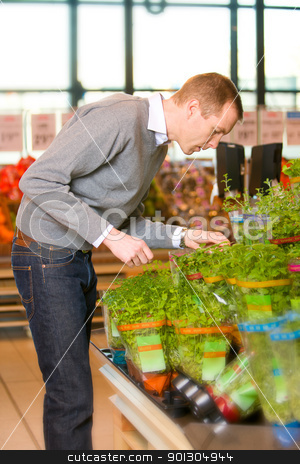 Fresh Herbs Grocery Store stock photo, A man buying fresh herbs at a grocery store by Tyler Olson