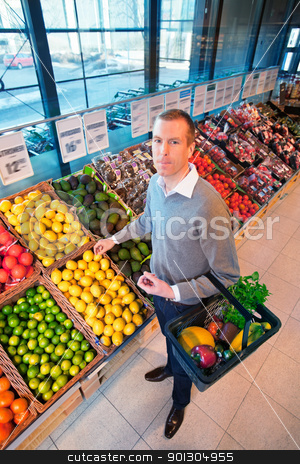 Portrait of a man buying fruits stock photo, Portrait of a man buying fruits in the supermarket by Tyler Olson