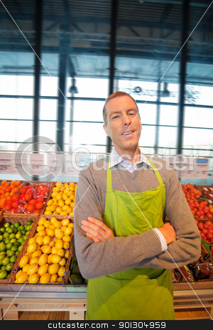Happy Shop Supermarket Owner stock photo, Portrait of a happy supermarket owner looking at the camera by Tyler Olson