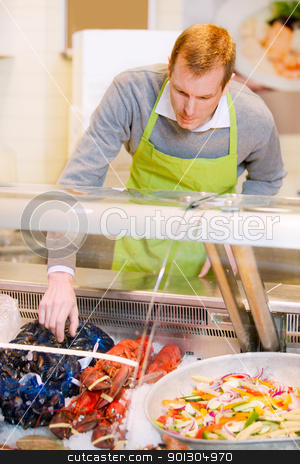 Seafood Fresh Food stock photo, A fresh fish counter and a grocery store by Tyler Olson