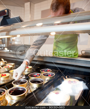 Fresh Gourmet Desert stock photo, A fresh gourmet desert counter in a store with faceless chef by Tyler Olson