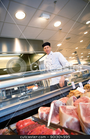 Fresh Meat Counter stock photo, A butcher looking at a fresh meat counter in a grocery store by Tyler Olson