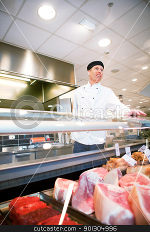 Fresh meat Butcher stock photo, A butcher helping a customer at a fresh meat counter or deli by Tyler Olson
