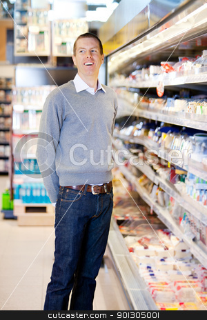 Happy Customer stock photo, Portrait of a happy smiling customer in a grocery store by Tyler Olson