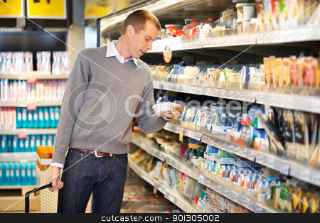 Shopping Man stock photo, Man buying goods in the supermarket by Tyler Olson