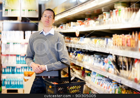 Serious Customer stock photo, Portrait of a serious customer in a grocery store by Tyler Olson