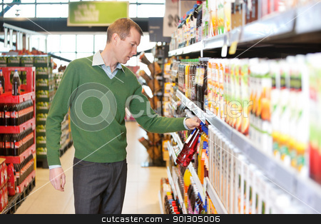 Man buying juice in the market stock photo, Man buying juice in the supermarket by Tyler Olson