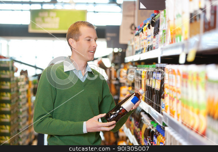 Customer buying bottle of juice stock photo, Customer buying bottle of juice in the supermarket by Tyler Olson