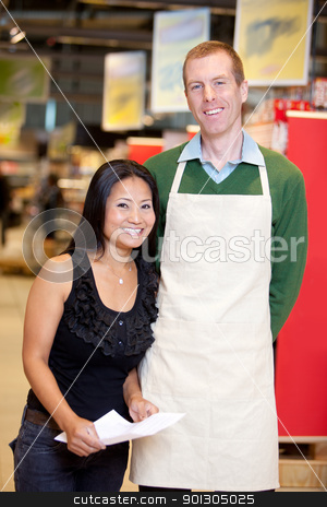 Grocery Stoer Owner With Customer stock photo, A male grocery store owner together with a customer by Tyler Olson