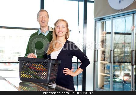 Supermarket Couple Portrait stock photo, A portrait of a happy couple in a supermarket buying groceries by Tyler Olson