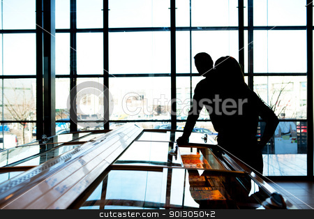 Grocery Store Silhouette stock photo, A silhouette of a couple in a trendy supermarket by Tyler Olson