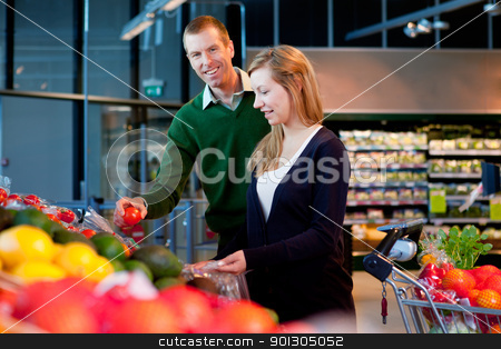 Supermarket Couple stock photo, A happy couple buying fresh produce in a supermarket by Tyler Olson