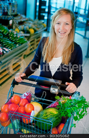 Woman in Supermarket stock photo, A portrait of a happy female shopper in a supermarket by Tyler Olson