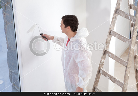 Painter painting the wall stock photo, Painter painting the wall with roller by Tyler Olson