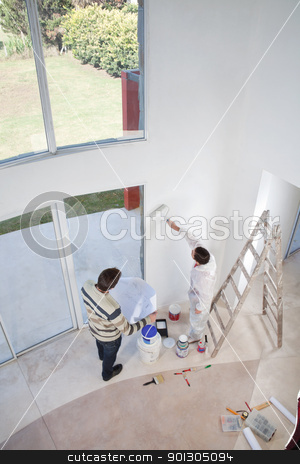 High angle view of two men at an apartment stock photo, High angle view of man holding blueprint and workman painting the wall by Tyler Olson