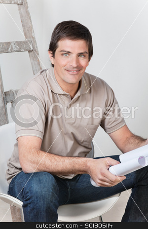 Man holding with blueprint stock photo, Portrait of young handsome man holding with blueprint by Tyler Olson