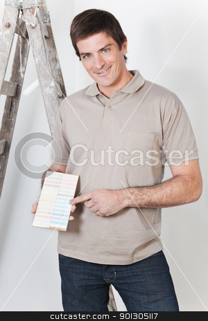 Man pointing at color guide stock photo, Portrait of a young handsome man pointing at color guide by Tyler Olson