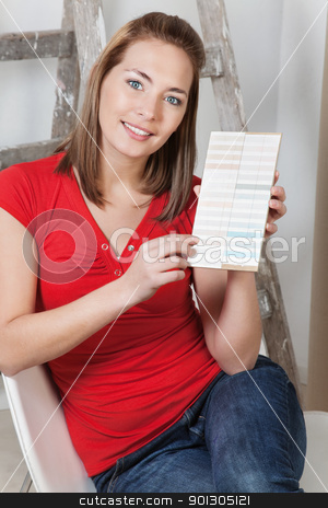 Woman pointing at color sample stock photo, Portrait of a young beautiful woman pointing at color sample by Tyler Olson