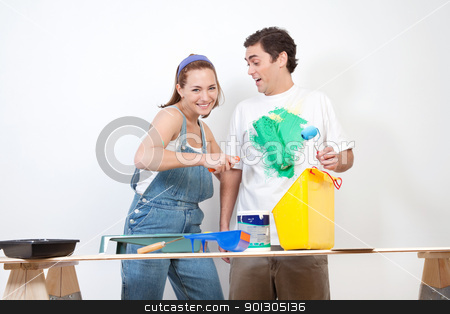 Woman painting color on her boyfriend's shirt stock photo, Happy Caucasian woman playing around with color on her boyfriend's shirt by Tyler Olson