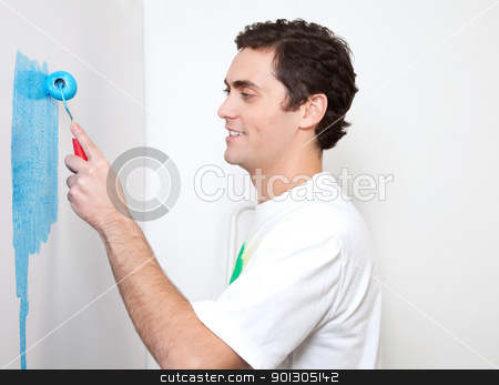 Happy young man applying color stock photo, Happy young man applying sky blue color to the wall by Tyler Olson