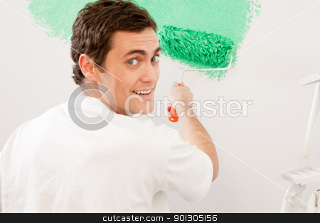 Home Improvement - Paint Wall stock photo, Portrait of a male doing home improvements, paiting a wall by Tyler Olson