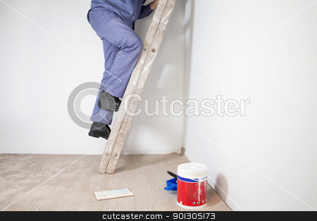 Man on Ladder stock photo, Low section of man's legs climbing wooden ladder by Tyler Olson