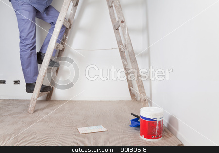 Ladder Detail stock photo, Low section of man's legs climbing wooden ladder by Tyler Olson