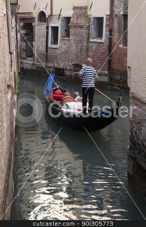 Gondolier in Venice, Italy stock photo, Gondolier in Venice, Italy by johnnychaos
