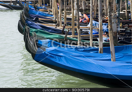 Parked gondolas in Venice, Italy stock photo, Many parked famous gondolas in Venice, Italy by johnnychaos